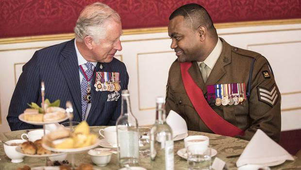 Charles talks with Victoria Cross recipient Johnson Beharry (Richard Pohle/The Times via PA)