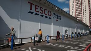 Retailers such as Tesco have seen shoppers queue up to buy goods throughout the pandemic (PA)