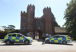 Police at the entrance to Lullingstone Castle in Eynsford, Kent, where a man died after reports of a disturbance in the grounds (Yui Mok/PA)