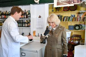 The Duchess of Cornwall smells an Arkell's Bees Organic Ale before taking a sip (Ben Birchall/PA)