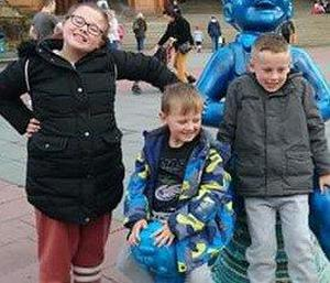 Fiona Gibson with brothers Alexander James and Philip, who died in hospital after the fire (Police Scotland/PA)