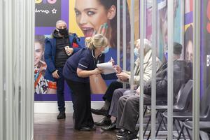 Social distancing measures put in place at Superdrug in Guildford as patients wait for the vaccine (Matt Alexander/PA)
