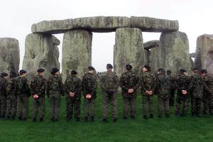 Army cadets and members of the Royal British Legion forming a circle of remembrance at Stonehenge in 2000 (Chris Ison/PA)