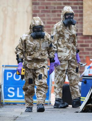 Members of the military wear protective clothing while investigating the home of Sergei Skripal following the poisonings (Andrew Matthews/PA)