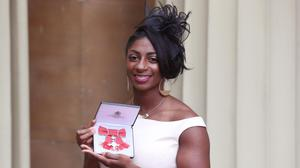 Kadeena Cox, seen here with her MBE, has had two World Championship medals stolen from her car returned ( Jonathan Brady/PA)
