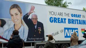A lorry carrying a message praising Captain Tom and the NHS passes his home in Bedford to mark his 100th birthday (Jacob King/PA)