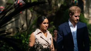 Harry and Meghan on an official tour after the duke launched a written attack on the media (Dominic Lipinski/PA)