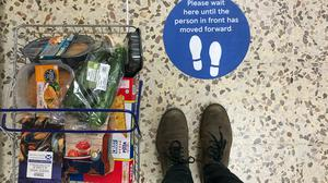 Social distancing markers at a Tesco Extra in Wembley as the UK continues in lockdown to help curb the spread of the coronavirus (Aaron Chown/PA)