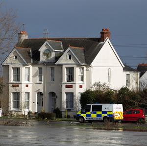 Police at houses on Thameside in Chertsey, Surrey, as properties were evacuated after two people and a child were admitted to hospital