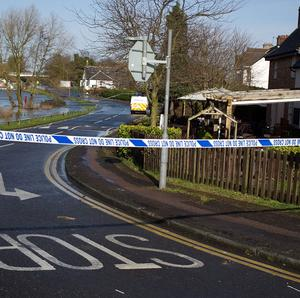 Police at houses on Thameside in Chertsey, Surrey