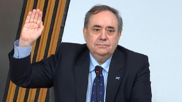 Former Scottish first minister Alex Salmond takes the oath before giving evidence to a Holyrood committee (Scottish Parliament TV/PA)