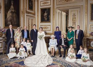 One photograph shows the families of both the bride and groom (Alex Bramall/PA)