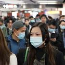 Passengers wear masks to prevent an outbreak of a new coronavirus in a subway station in Hong Kong (Kin Cheung/AP)