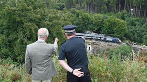 The Prince of Wales is shown the scene of the ScotRail train derailment near Stonehaven, Aberdeenshire, (Ben Birchall/PA)