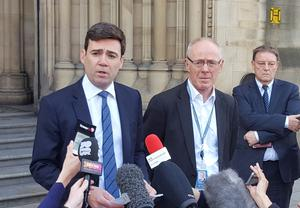Mayor of Greater Manchester Andy Burnham and Manchester City Council Leader Sir Richard Leese have called for more support for businesses (Dave Higgens/PA)