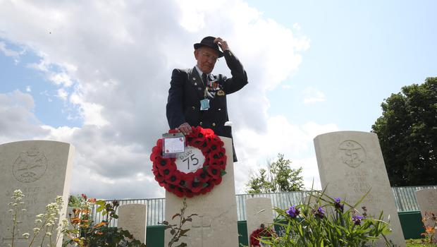 D-Day veteran Vincent Horton lays a wreath at the Commonwealth War Graves Commission Cemetery, in Bayeux (Jane Barlow/PA)