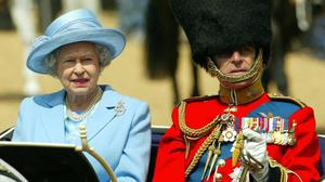 Queen Elizabeth II and The Duke Of Edinburgh arrive to inspect the troops at London's Horse Guards.