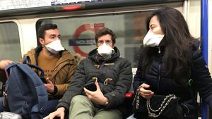 People wearing face masks on the London Underground.