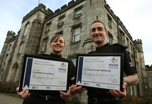 Laura Sayer and Kenneth MacKenzie received bravery awards at the Scottish Police College (Andrew Milligan/PA)
