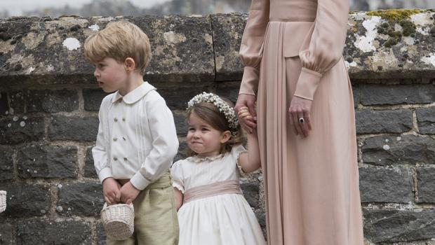 Prince George and Princess Charlotte at the wedding of Pippa Middleton and James Matthews (Arthur Edwards/The Sun/PA)