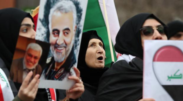 Protesters demonstrate outside the US Embassy in London over the killing of General Qassem Soleimani (Gareth Fuller/PA)