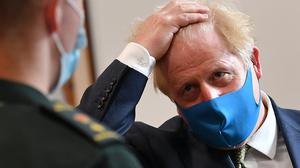 Scientists have warned Boris Johnson may struggle to deliver a return to 'normality' by Christmas (Ben Stansall/PA)