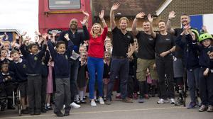 Prince Harry waves at the end of the filming of an episode of the Sky Sports 'Game Changers' television show dedicated to the Invictus Games flanked by, (left to right) presenters Darren Campbell and Di Dougherty and competitors Scott Meenagh, Mary Wilson and Stuart Robinson at Lambs Lane Primary School in Spencers Wood, near Reading.
