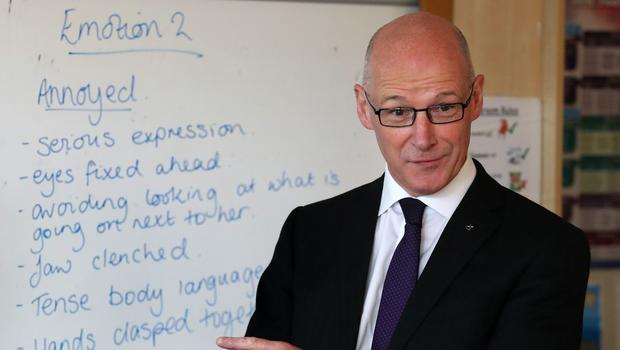 Education Secretary John Swinney has confirmed £50 million of funding to help tackle Scotland's attainment gap (Andrew Milligan/PA)