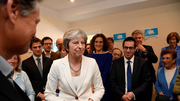 Theresa May speaks to supporters during a visit to Finchley and Golders Green Conservative Association in Barnet (Toby Melville/PA)