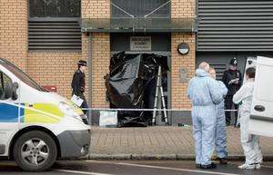 Forensic officers at the scene in Enfield, north London, where a 52-year-old man was stabbed