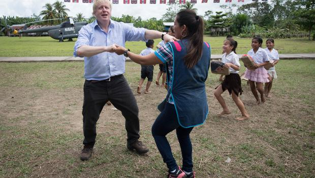 Boris Johnson dancing with infant class teacher Adriana Pinedo at the village school in Santa Marta, on the bank of the Amazon (Stefan Rousseau/PA)