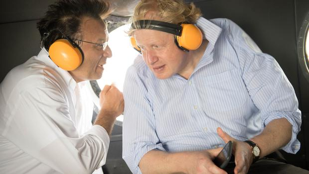 Boris Johnson on board a helicopter with his Peruvian counterpart Nestor Popolizio during a visit to the Amazon rainforest (Stefan Rousseau/PA)
