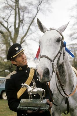 Captain Mark Phillips with the Queen's horse Columbus (PA)