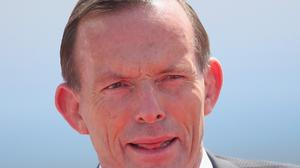 "Tony Abbott accused Russian of appearing to be trying to recreate the ""lost glories"" of the Soviet Union"