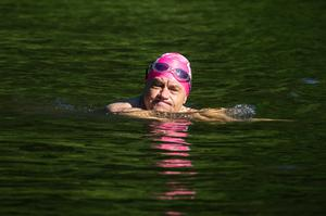 A swimmer in the Hampstead Heath mixed bathing pond in London (Aaron Chown/PA)