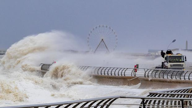 Waves crash over a lorry on Blackpool waterfront as weather warnings for wind, snow and ice have been issued (Peter Byrne/PA)