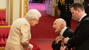 Harry Billinge speaks to the Queen during the ceremony (Dominic Lipinski/PA)
