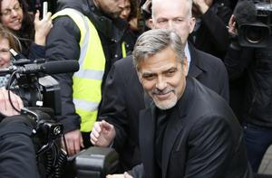 George Clooney was surrounded by media and fans during his visit to Edinburgh in 2015 (Danny Lawson/PA)