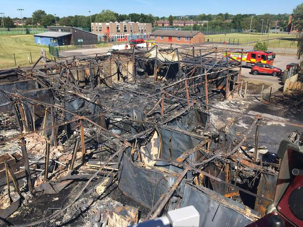 An aerial view of the remains of Harrington Junior School in Long Eaton, Derbyshire, after a fire destroyed the premises on Thursday. (Credit: Derbyshire Fire and Rescue Service/PA).