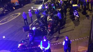 Police at the scene after an acid attack in London (@sarah_cobbold)