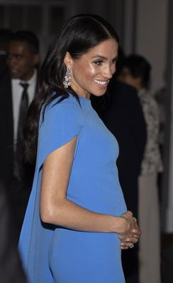 The duchess's growing bump is evident at a state dinner at the Grand Pacific Hotel in Suva, Fiji (Ian Vogler/Daily Mirror/PA)