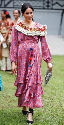 Meghan, in a printed wrap dress by Figue featuring pom-poms and a ruffled asymmetrical hem, at the University of the South Pacific in Suva, Fiji (Phil Noble/PA)