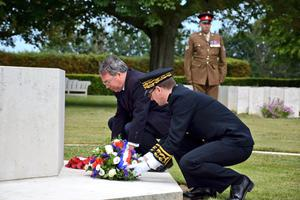 British Ambassador to France Edward Llewellyn lays a wreath during the ceremony (Prefecture du Calvados-BV/PA)