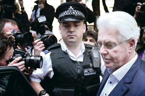 Publicist Max Clifford leaves Southwark Crown Court in London yesterday after being found guilty of eight indecent assaults