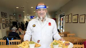 Liberal Democrat leader Sir Ed Davey puts in a shift in Taylors fish and chip shop in Stockport at the start of his national 'listening tour' (Danny Lawson/PA)