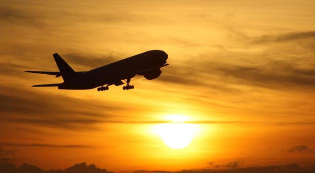 The Government is to review air passenger duty on domestic routes (Steve Parsons/PA)