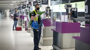 Screens at the Edinburgh Airport check-in desks are disinfected (Jane Barlow/PA)