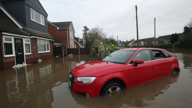 A car in floodwater outside a house in Fishlake (Danny Lawson/PA)