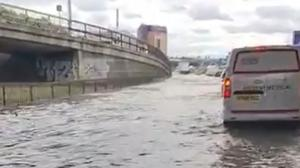 Eight people were rescued from vehicles that became stranded in floodwater on the North Circular Road (@Darryn1970/PA)