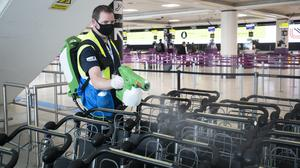 Luggage trolleys are disinfected at Edinburgh Airport (Jane Barlow/PA)